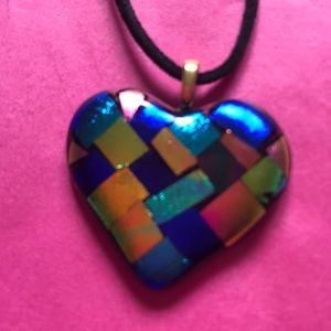 Black necklace with multicolored heart pendant